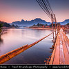 Asia - Laos - Vientiane Province - Vang Vieng - Small traditional town surrounded by Limestone Hills - Bamboo footbridge bridge over Nam Song River