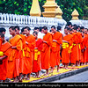 Asia - Laos - Luang Prabang - Louangphrabang - UNESCO World Heritage Site - Ancient royal capital at confluence of Mekong River & Nam Khan river - One of the most charming and best preserved towns in Southeast Asia with 34 Buddhist temples & monasteries in backdrop of lush green mountains - Tak Bat - Morning Alms Giving - Practice of offering food to orange-robed Buddhist monks at start of every new day