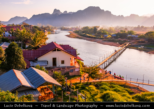 Asia - Laos - Vientiane Province - Vang Vieng - Small traditional town surrounded by Limestone Hills - Bamboo footbridge bridge over Nam Song River‏