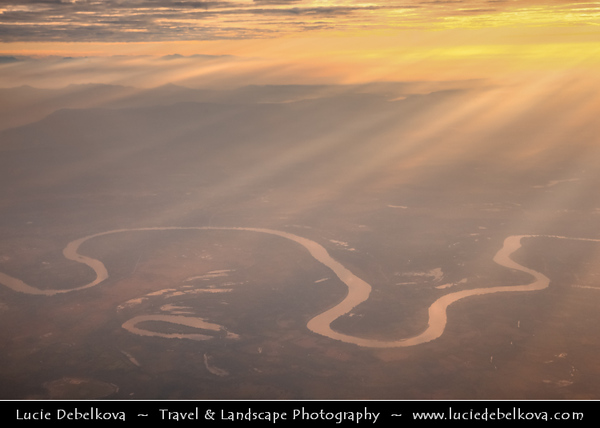 Asia - Laos - Luang Prabang Province - Stunning Golden Sunrise over Mekong River and Surrounding Mountains - Aerial View