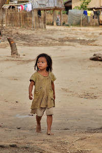 northern Laos A little girl walks through her Khmu village.