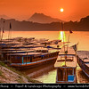 Asia - Laos - Luang Prabang - Louangphrabang - UNESCO World Heritage Site - Ancient royal capital at confluence of Mekong River & Nam Khan river - Traditional life along the Mekong River full of  long tail boats - Sunset