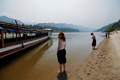 northern Laos After damage to the boat pulling out of port, the owners ran aground on this small beach to repair the damage.  We got to put our feet in the cool waters of the Mekong for awhile.
