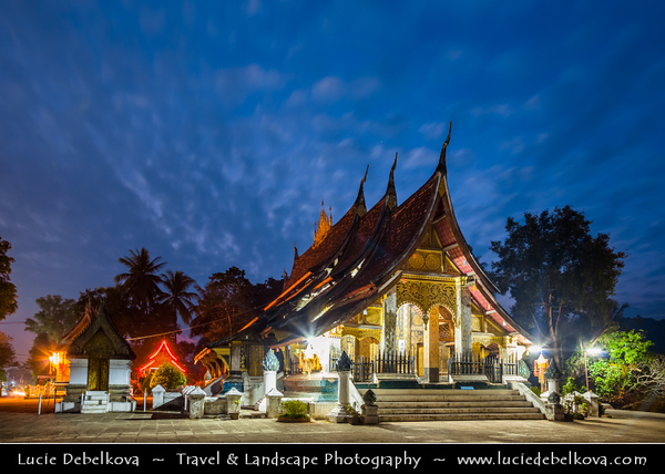 Asia - Laos - Luang Prabang - Louangphrabang - UNESCO World Heritage Site - Ancient royal capital at confluence of Mekong River & Nam Khan river - One of the most charming and best preserved towns in Southeast Asia with 34 Buddhist temples & monasteries in backdrop of lush green mountains - Buddist temples at Dusk - Twilight - Blue Hour - Night