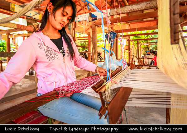 Asia - Laos - Luang Prabang - Louangphrabang - UNESCO World Heritage Site - Traditional way of weaving local fabrics