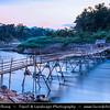 Asia - Laos - Luang Prabang - Louangphrabang - UNESCO World Heritage Site - Ancient royal capital at confluence of Mekong River & Nam Khan river - One of the most charming and best preserved towns in Southeast Asia with 34 Buddhist temples & monasteries in backdrop of lush green mountains - Traditional life along the Mekong River full of  long tail boats