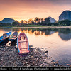 Asia - Laos - Vientiane Province - Vang Vieng - Small traditional town surrounded by Limestone Hills - Nam Song River‏ with long tail boats