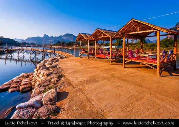 Asia - Laos - Vientiane Province - Vang Vieng - Small traditional town surrounded by Limestone Hills & Nam Song River - Local open air restaurants serving delicious food