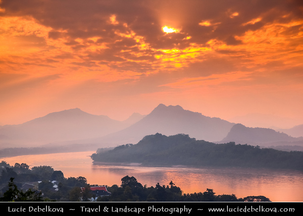 Asia - Laos - Luang Prabang - Louangphrabang - UNESCO World Heritage Site - Ancient royal capital at confluence of Mekong River & Nam Khan river - One of the most charming and best preserved towns in Southeast Asia with 34 Buddhist temples & monasteries in backdrop of lush green mountains - Sunset over Mekong River