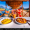 Asia - Laos - Vientiane Province - Vang Vieng - Small traditional town surrounded by Limestone Hills & Nam Song River‏ - Local open air restaurants serving delicious food