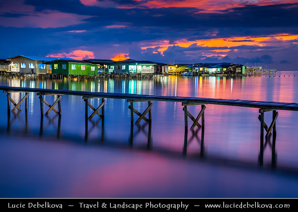 Southeast Asia - Malaysia - Borneo - Sabah - Kota Kinabalu - Dramatic Sunset at Water Village - Stilt Houses in shallow waters of South China Sea