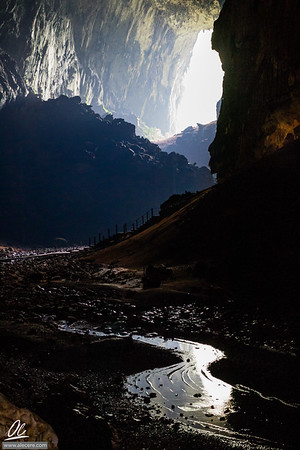 Light and shadows, rock and water, mud and slippery wood (and guano). And then we saw the exit.