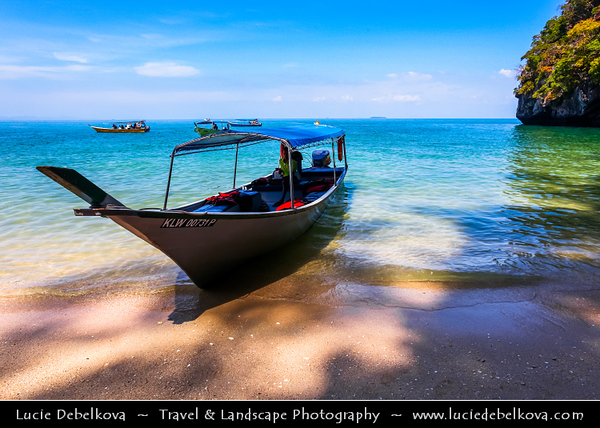 Malaysia - Kedah - Pulau Langkawi - Langkawi Island - Kilim Karst Geoforest Park - Located at the East of Langkawi Island -  Kilim Karst Geoforest Park is located at the East of Langkawi Island - Crystal clear beach of Andaman Sea - Traditional Local Boat
