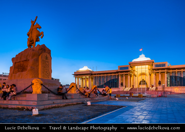 Asia - Mongolia - Монгол улс - Land of Vast Steppes & Kind Nomads - Ulan Bator - Ulaanbaatar - Улаанбаатар - The Red Hero - The capital and largest city of Mongolia - Modern Cityscape - Sükhbaatar Square - Сүхбаатарын талбай - Sükhbaatariin Talbai - Central square of Ulaanbaatar named after & features a statue of Damdin Sükhbaatar, leader of Mongolia's 1921 revolution- Statue is located right in front of the Saaral Ordon (Government Palace) - Dusk - Twilight - Blue Hour