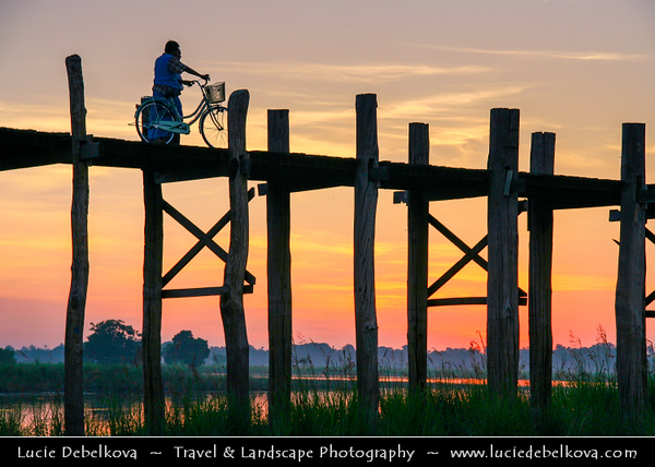 Asia - Myanmar - Burma - Mandalay - U Bein Bridge - ဦးပိန် တံတား - Crossing that spans Taungthaman Lake near Amarapura in Myanmar - 1.2-kilometre (0.75 mi) bridge was built around 1850 and is believed to be the oldest and longest teakwood bridge in the world