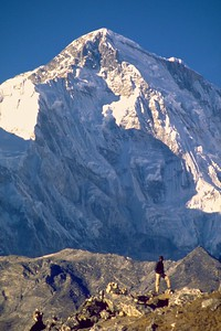 A trekker takes in the view of the Himalayan range