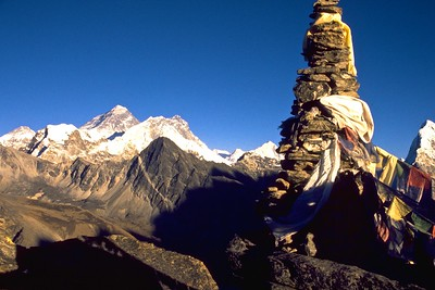 Cairn and prayer flags with Everest, Lhotse and Makalu in the background