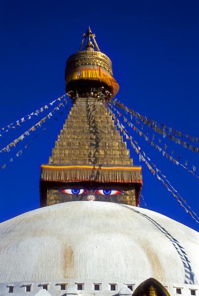 Budda watches, Main buddist temple in boddaman near Kathmandu, Nepal