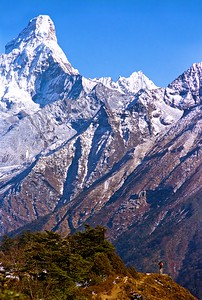 Lone trekker looks toward the summit of Cholatse