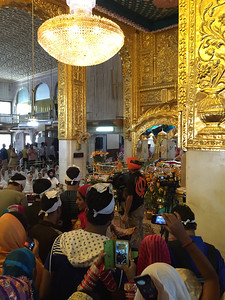Inside Gurudwara Bangla Sahib, throngs of people trying to get a glimpse of the proceedings.