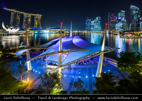 Singapore - Marina Bay - City view from roof top promenade of Esplanade Theatres on the Bay - Waterside building located on six hectares of waterfront land alongside Marina Bay near the mouth of the Singapore River, purpose-built to be the centre for performing arts for the island nation of Singapore - Twilight - Dusk - Blue Hour - Night