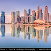 Singapore - Financial District Reflected in Waters of of Marina Bay - Area of commercial, residential, hotel and entertainment space