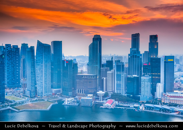 Singapore - Marina Bay - Central Business & Financial District with High-rise Buildings & Skyscrapers - Area of commercial, residential, hotel and entertainment space - Aerial View - Sunset