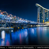 Singapore - Marina Bay - Marina Bay Sands Hotel - Integrated resort fronting Marina Bay & Helix Bridge - Steel footbridge, opened in 2010, inspired by the curved form of the structure of DNA - Twilight - Dusk - Blue Hour - Night