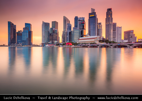 Singapore - Marina Bay - Central Business & Financial District with High-rise Buildings & Skyscrapers - Reflected in Waters of of Marina Bay - Area of commercial, residential, hotel and entertainment space - Sunset