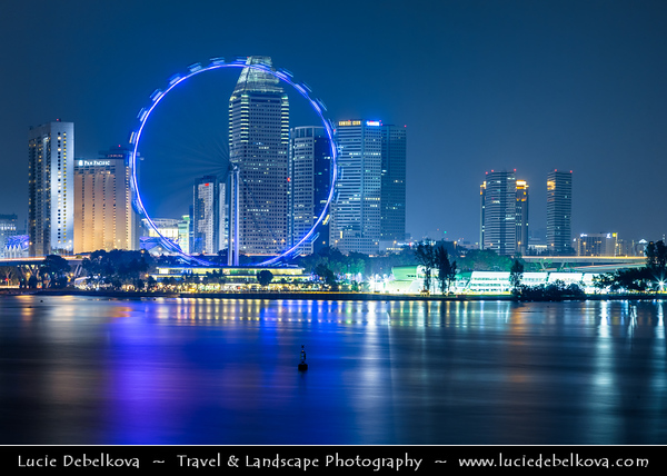 Singapore - Marina Bay - City Skyline with Singapore Flyer - Giant Ferris Observation wheel reaches 42 stories high, with a total height of 165 m (541 ft), making it the tallest Ferris wheel in world - Twilight - Dusk - Blue Hour - Night