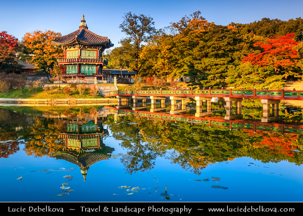 Asia - South Korea - Seoul - Gyeongbokgung Palace - Gyeongbok Palace - Main and largest royal palace of the Joseon dynasty built in 1395 - Iconic historical, two-story hexagonal Hyangwonjeong Pavilion on a small island in the middle of the lake - Autumn/ Fall Time