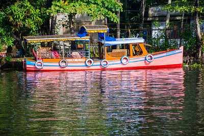 Colorful boats ply the waters