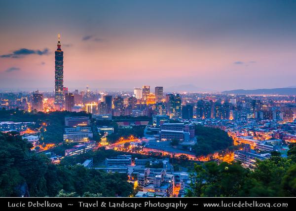 Asia - Taiwan - Republic of China (ROC) - Taipei City - 臺北市 - 台北市 - Capital City - Dusk over Modern Skyline &  Taipei 101 - Taipei World Financial Center - Landmark skyscraper located in Xinyi District