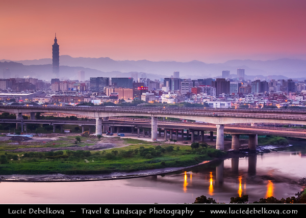 Asia - Taiwan - Republic of China (ROC) - Taipei City - 臺北市 - 台北市 - Capital City - Modern Skyline & Tamsui River - Taipei 101 - Taipei World Financial Center - Landmark skyscraper located in Xinyi District - Early Morning Sunrise