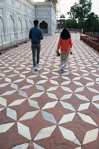 Walking up to the Taj Mahal over centuries-worn sandstone and marble tiles. Note the booties over Sheri's and our guide's shoes.