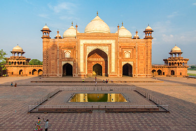 The shadow of the Taj Mahal falls on the mosque to its west.