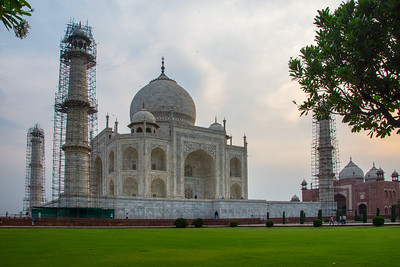 Minarets of the Taj Mahal in scaffolding as seen from the beautiful gardens surrounding it.