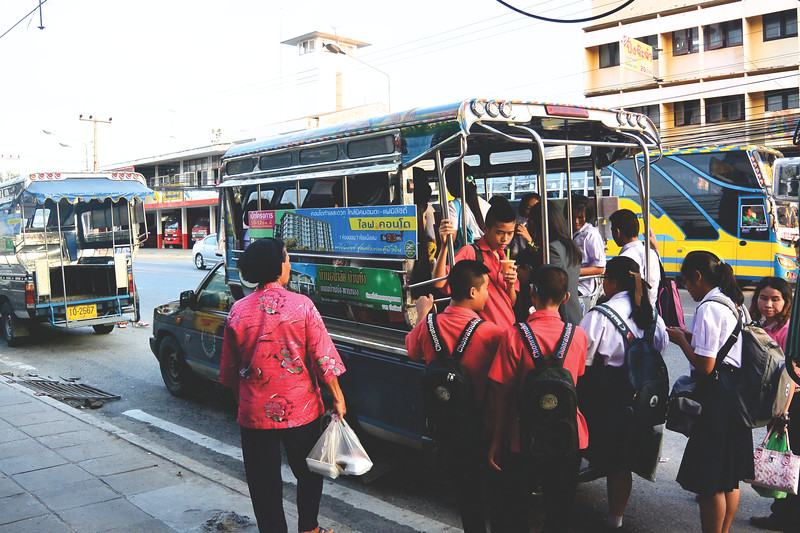 The main form of transportation - a songthaew. Students cramming into one after school is out. November 2014