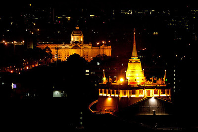 Bangkok, Thailand In the background on the left side is the Ananta Samakhom Throne Hall, and in the foreground on the right is the chedi at Wat Saket (Temple of the Golden Mount).