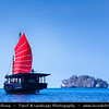Thailand - Krabi - Railay Beach - Traditional Red Sail boat sailing among limestone islands