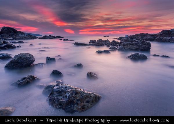 Thailand - Phuket Island - Patong Beach - Tropical beach resort town facing Andaman Sea with sandy shores - Dramatic Sunset