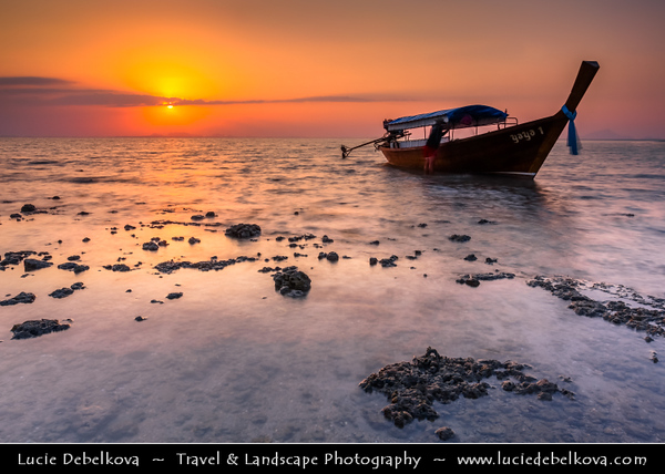 Thailand - Krabi - Railay Beach - Small peninsula with white sand beaches, soaring limestone cliffs & caves on shores of Andaman Sea - Traditional local boat at Sunrise