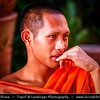 Thailand - Chiang Mai - Local buddhist monk wearing traditional orange color robe at their daily life