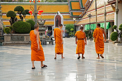 Bangkok, Thailand Monks walking through Wat Suthat Thep Wararam.