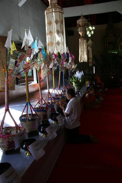 Making a prayer at your birthday buddha