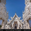 Thailand - Chiang Rai - Golden Triangle - Wat Rong Khun - White Temple - Contemporary Buddhist temple with unique & intricate white exterior
