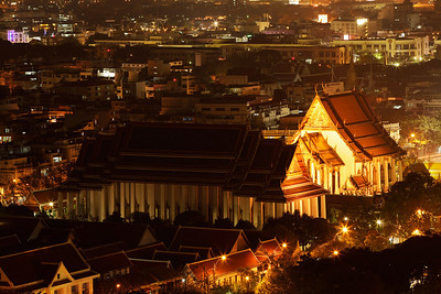Bangkok, Thailand Wat Suthat Thep Wararam at night.