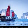 Thailand - Krabi - Railay Beach - Traditional Red Sail boat sailing among limestone islands