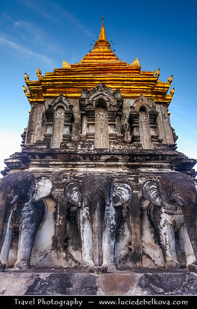 Thailand - Chiang Mai - Wat Chiang Man - 13th-century temple with a gold chedi offering ancient Buddha & elephant statues on scenic grounds - Sacred Elephant Encircled Stupa