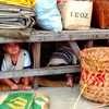 Kids Playing Under Floorboards, Open Market - Bangkok, Thailand